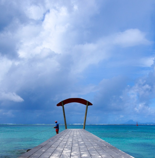 Fisherman on a dock in Huahine, Society Islands