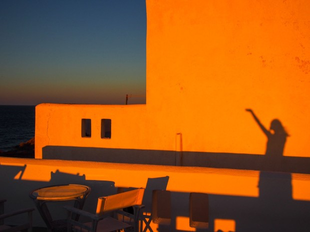 Sunset glow on Santorini rooftop