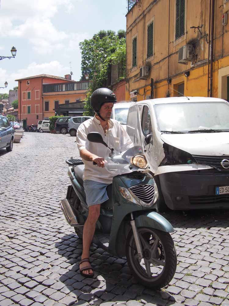 Riding a moped around Rome